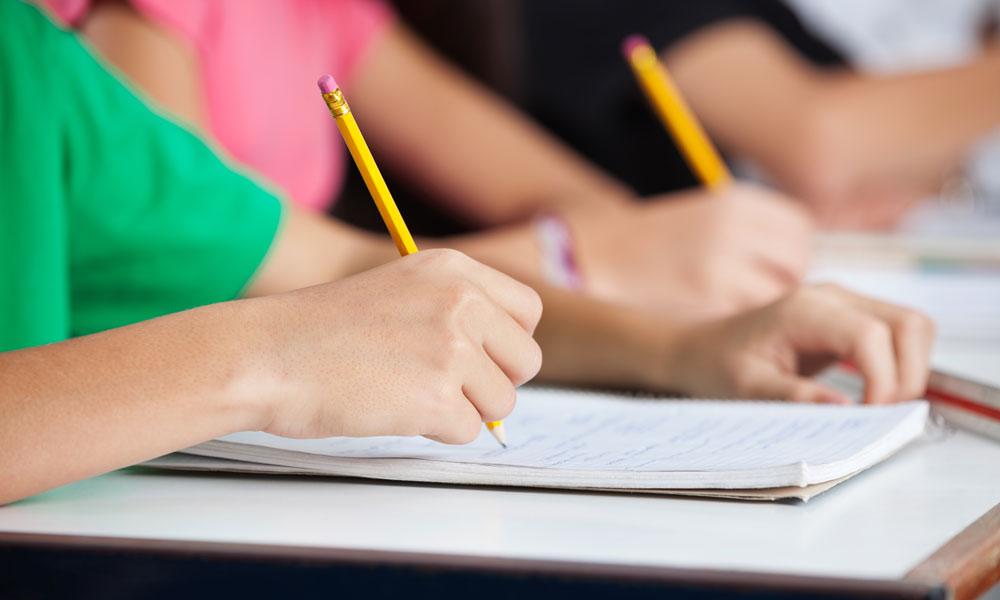 students writing stock image