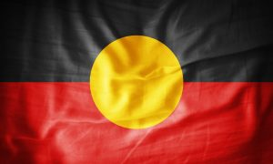 Aboriginal flag fabric stock image