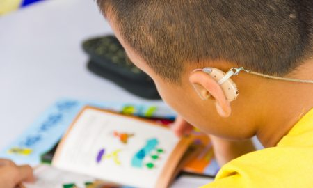 child hearing aid stock image