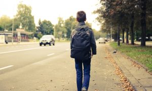 kid walks to school stock image