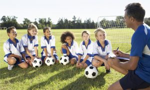 sports kids team with coach stock image