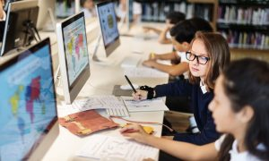 students on computers stock image