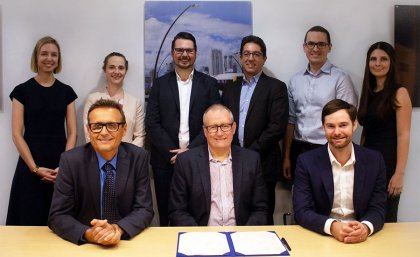 Front row: UQ School of Civil Engineering head Professor Simon Washington, UQ Director of Research Partnerships Joe McLean, VLC CEO Tim Veitch. UQ's Dr Jake Whitehead (back row, third from left)