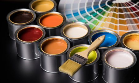 paint cans and brushes stock image