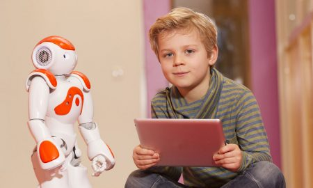 child and robot friend stock image