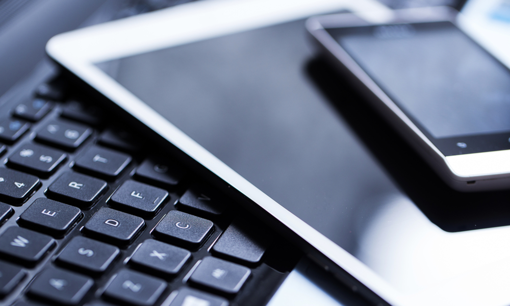 laptop tablet phone technology stock image