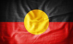 Aboriginal flag fabric stock image